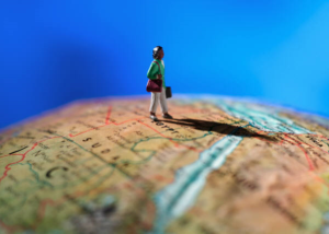 Expat-life-Model-of-a-woman-standing-on-a-globe